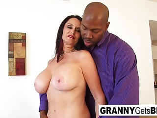 Busty dark-haired granny takes the dusky cock adjacent to her raw pussy